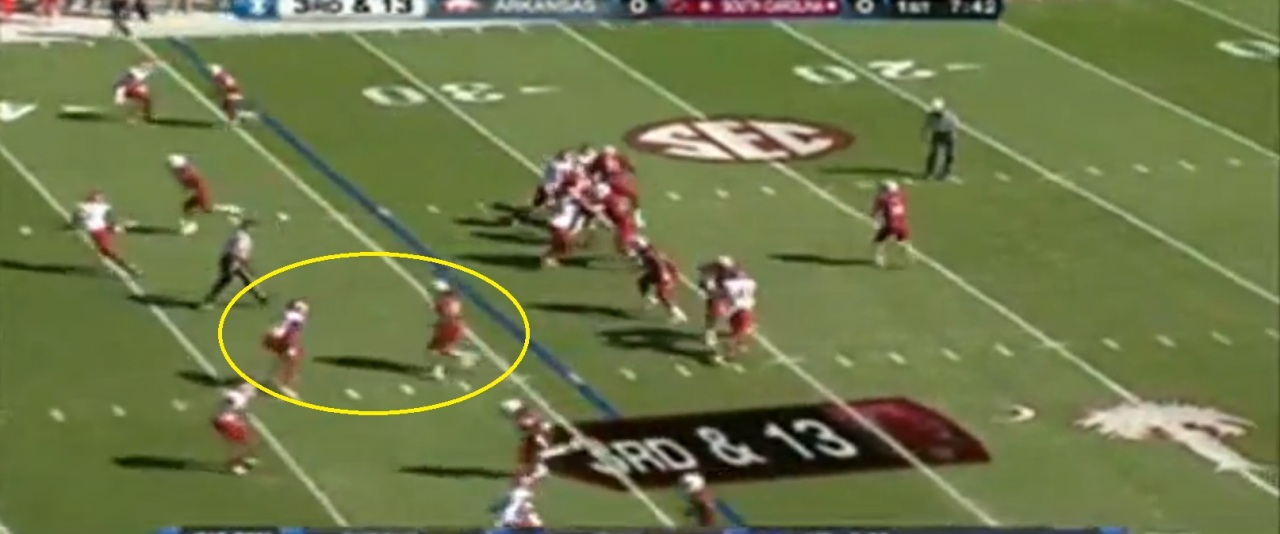 Justice's head, knees, and arms all indicate he's about to break inside or hook under the linebacker.