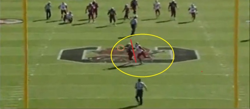Cunningham extends for the ball, makes the catch, and has his back shielding the defender due to his turn.
