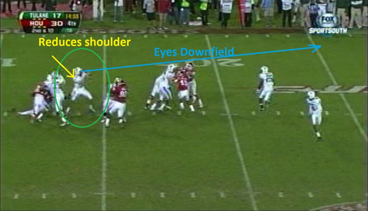 Griffin does a fine job of reducing his shoulder from the outside pressure and climbs the pocket with his eyes down field.