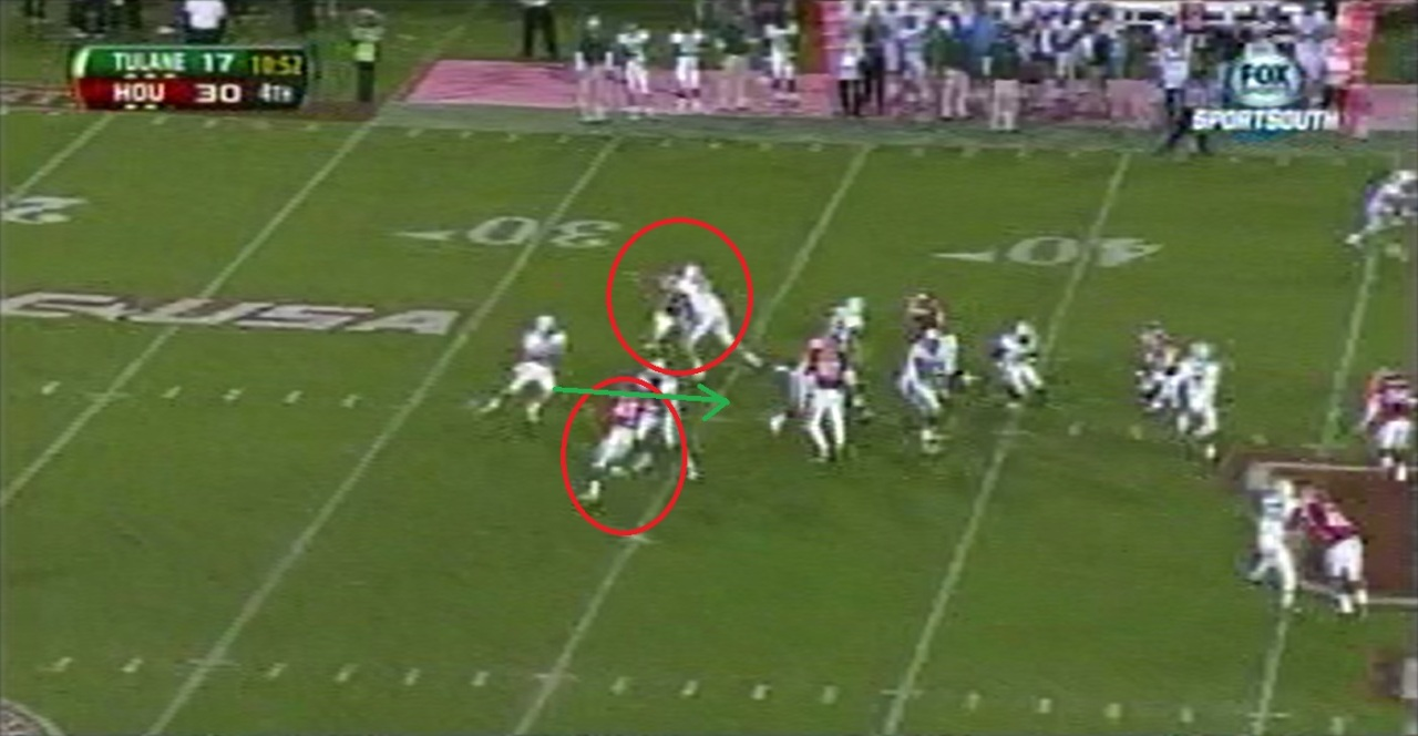 Griffin takes three hitch steps to climb the pocket between edge rushers.